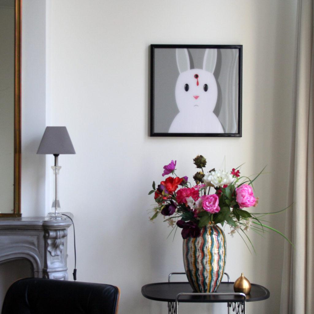 Artprint of a dead rabbit, printed behind plexiglass